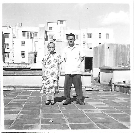 Author Edward Ng in 1958, 1 year after school certification (with grandma)